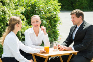 Group Of Young Happy Businesspeople Having Break From Work
